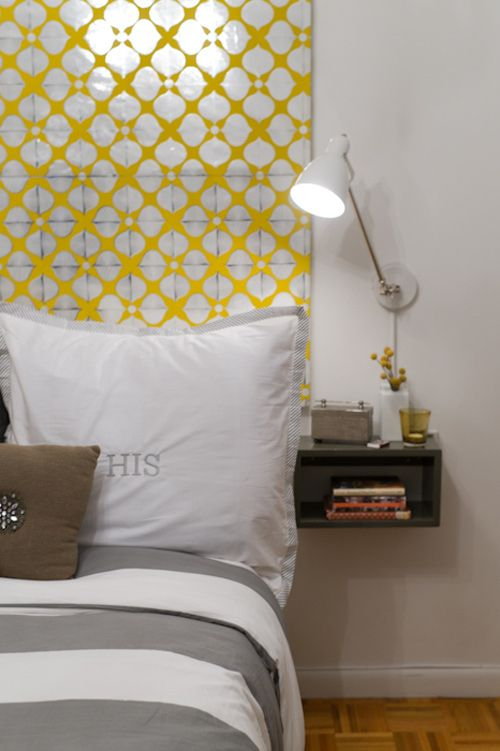 The wall behind the bed is decorated with a large canvas covered with wallpaper. Smart & simple decorating idea!