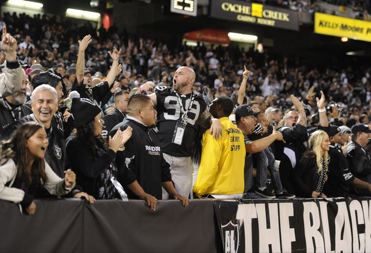 Oakland Raiders fans celebrate in the Black Hole during the 4th quarter in an preseason game between the Oakland Raiders and the Dallas Cowboys at O.co Coliseum.