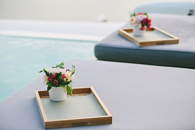 Trays decorated and ready for the waiters to place cocktails - Behind the Scenes of a Santorini Wedding - by Stella And Moscha - Photography by Thanos Asfis & Yiannis Alefantou