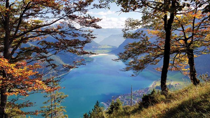 """""""I went to Lake Achensee and did a walk around the lake. It was lovely to be amongst nature - walking wee paths and crossing little wooden bridges. The lake was so unbelievably blue, the kind of blue people think you only get in tropical places. We stopped at a cafe and had a lunch of traditional cheese and meat - it was SO yummy. Good walking fuel."""" – Iona, Thomson Lakes & Mountains team."""