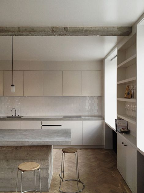 Neutral tones and natural textures employed in a beautiful renovation of Queens Court in West London by Feilden Fowles.