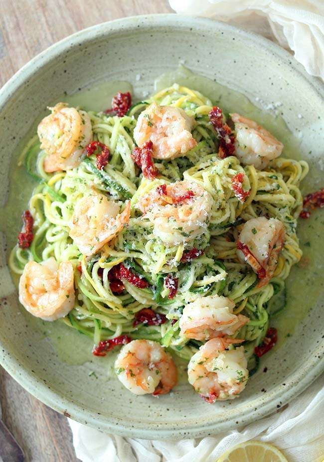 Boost your next pasta dish with this amazingly tasty and easy to make Zucchini Noodles with Pesto and Shrimp Scampi Recipe!