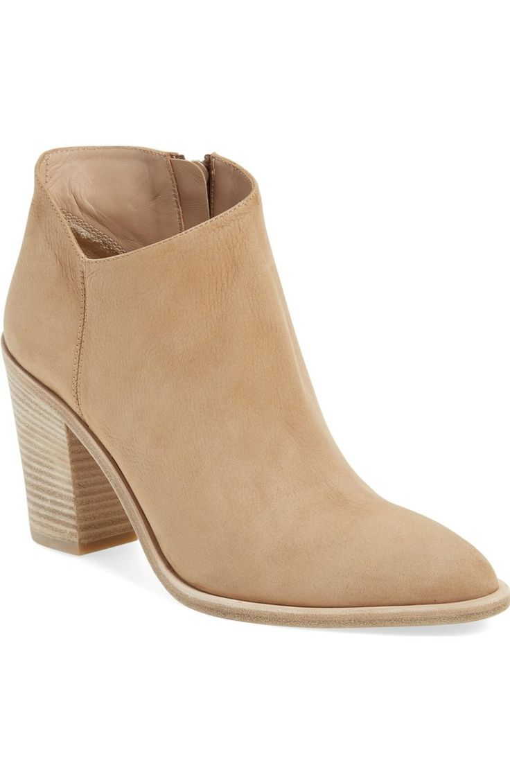 This chic ankle bootie with a hint of Western flair gets a contemporary update with a sleek almond toe and a low, dipped topline.