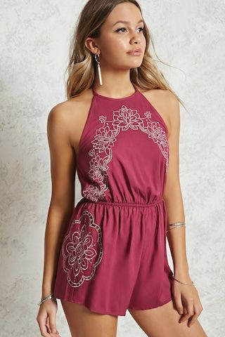 A woven romper featuring a metallic floral embroidery, halter neckline, self-tie closures, and an elasticized waist.