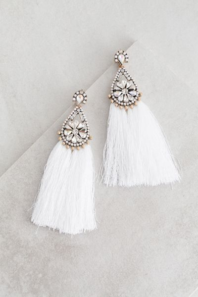 White tassel statement earrings for a bold style!