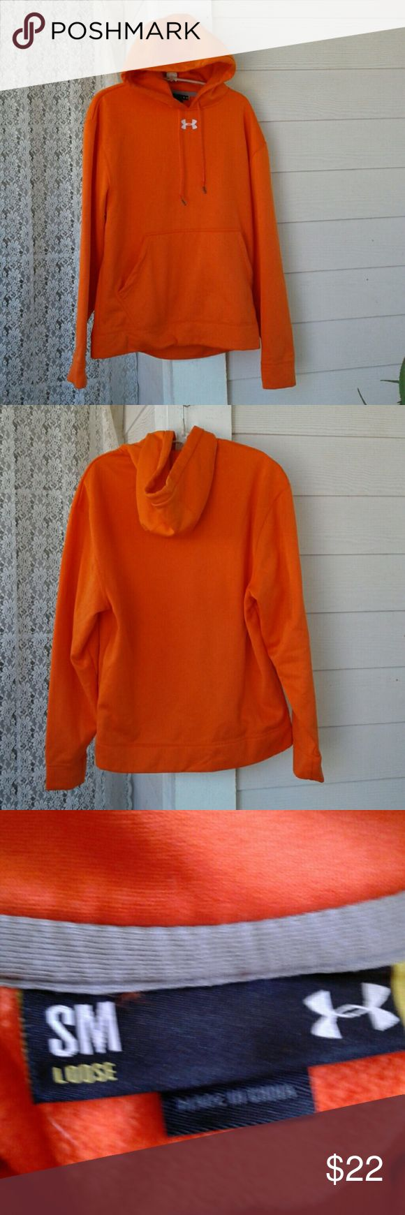 "UNDER ARMOUR WOMEN'S ORANGE HOODIE SIZE SM (small medium),DRAWSTRING HOODIE PULL, FLEECE LINING,  FRONT KANGAROO POCKET,  WHITE EMBROIDERED LOGO, 25"" LONG, 24"" SLEEVES, 23"" ARM PIT TO ARM PIT, ♡♡♡♡GREAT PRE-LOVED CONDITION♡♡♡ UNDER ARMOUR Tops Sweatshirts & Hoodies"