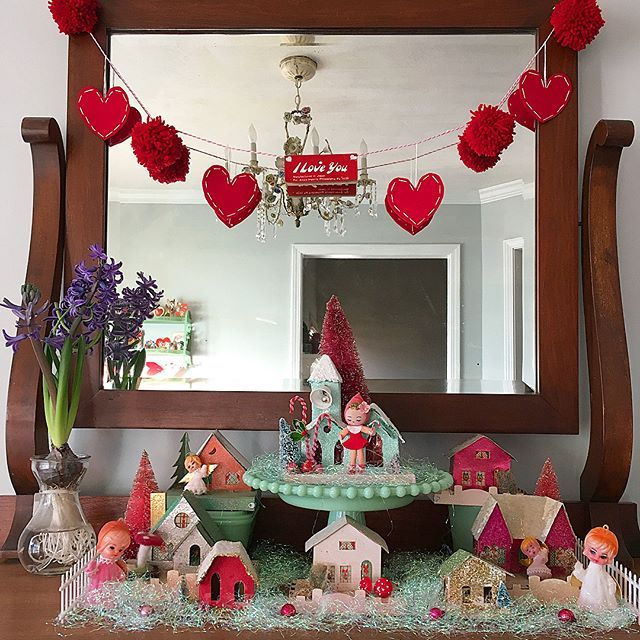I wasn't ready to see the Putz houses go, so I left out the pinks and whites. Exchanged the deer and Santa for flocked angels = Valentine's Village  #putzhouse #jadeite #valentinesdecor