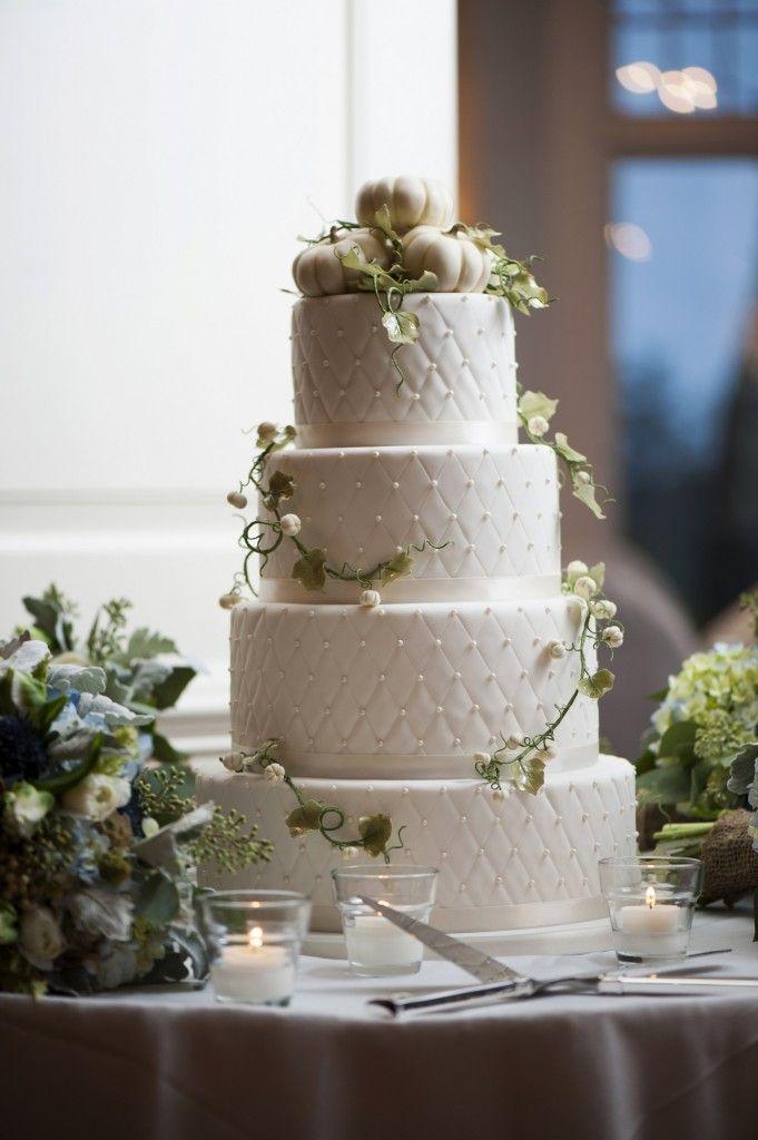 Elegant white pumpkins wedding cake for fall wedding.
