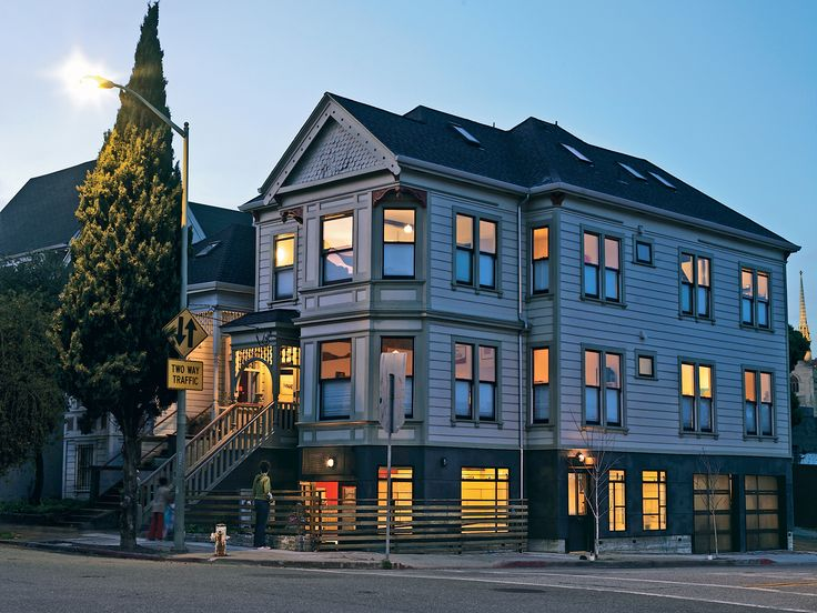 Oakland, California, doesn't want for stately old Victorian houses, but heritage and zoning regulations often make them tough to renovate, particularly if you have an aesthetic depar-ture in mind. By raising the house, Mike McDonald was able to preserve the façade and create a modern new office space below.