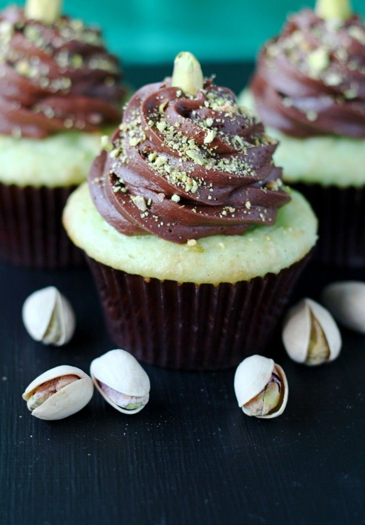 Chocolate Pistachio Cupcakes 1 box White or Yellow cake mix 1 (3.4 oz) box pistachio instant pudding 4 eggs 1 cup buttermilk 1/4 cup oil 1/2 teaspoon almond extract 3/4 cup sour cream Chocolate Buttercream: 3/4 cup butter, softened 4 oz cream cheese, softened 2 teaspoons vanilla extract 3/4 cup unsweetened cocoa 3-4 cups powdered sugar