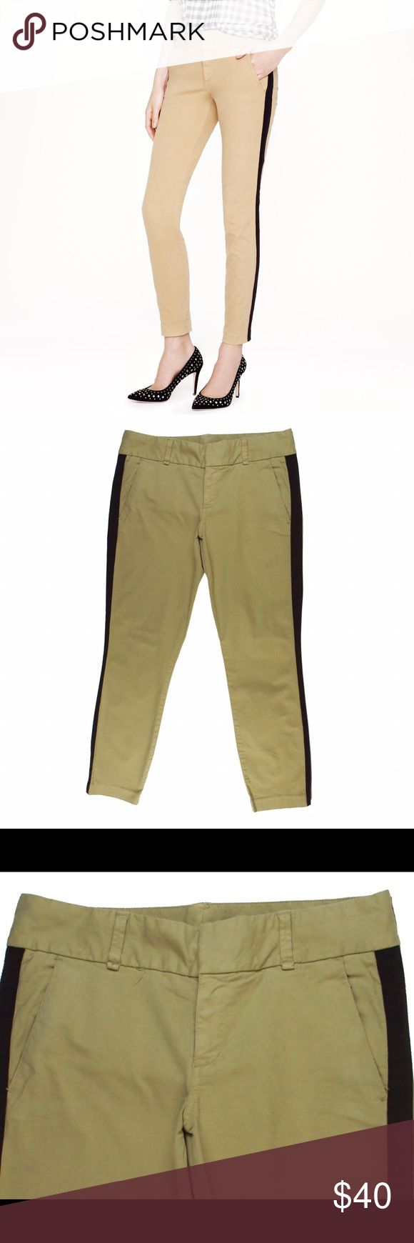 """JCREW Andie Chino Slim Leg Tuxedo Stripe Pants Excellent condition. Color is most accurate in the first pic (cover shot). These khaki Andie chinos from JCREW feature a slim leg, ankle length inseam and black tuxedo stripe down the legs. Made of a cotton blend. Measures: waist: 32"""", rise: 8.5"""", hips: 39"""", inseam: 28"""" J. Crew Pants"""
