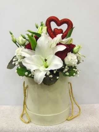 white red heart flowers in a box White lilies ,orchids and red roses in a round luxury box for your love !  Available for Athens -Attiki after pre-order one labor day before.  Σύνθεση με λευκά μυρωδάτα λίλιουμ ,τριαντάφυλλα κόκκινα σε στρογγυλό κουτί πολυτελείας. www.flowers4u.gr  flowers Papadakis est 1989