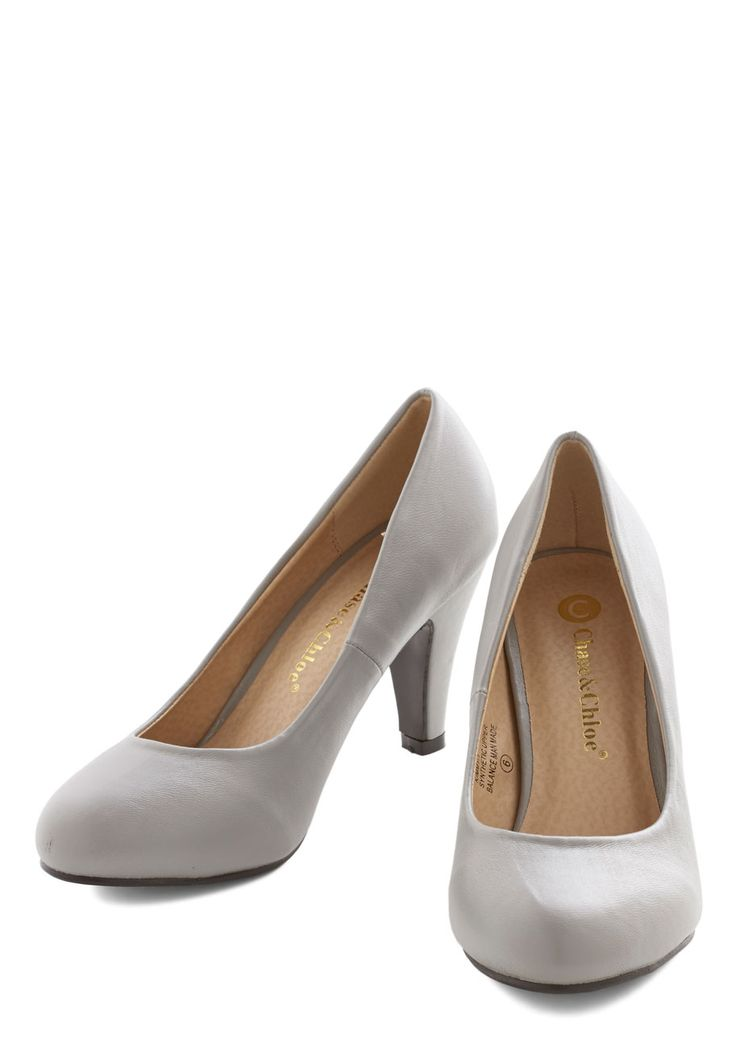 In a Classic of Its Own Heel in Grey. Many shoes have eye-catching patterns or flirty designs, but sometimes the most basic pumps - like these grey heels - can become your very favorite.