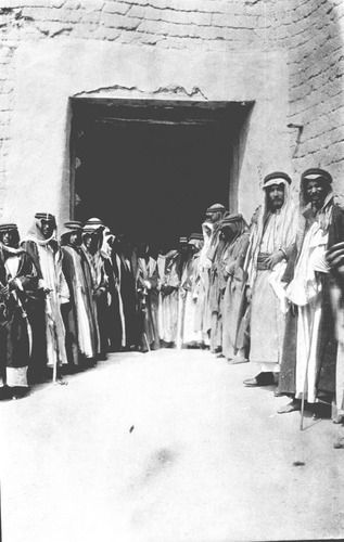 The main gate of the Barzan place and these people standing to receive and welcome guests.