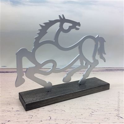 Horse sculpture: aluminum with maple base. Artist: Shirley Lloyd-Davies & Kelly Crosson/Dundee Designs Inc.