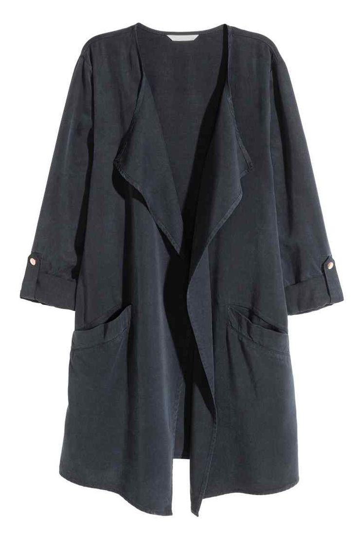 Veste en lyocell mélangé: Veste longue en tissu souple de lyocell Tencel® mélangé. Modèle avec revers drapés et poches devant. Manches longues retroussables par patte pressionnée. Non doublé.