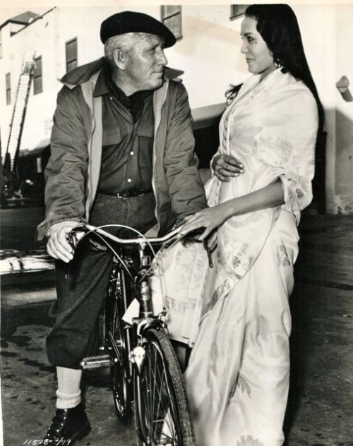Spencer Tracy rides a bike. Anna Kashfi gets a grip.