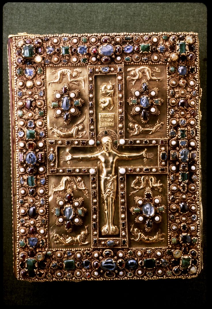 """Front cover - Early medieval treasure bindings with a structure in precious metal, and often containing gems, carved ivory panels or metal reliefs, are perhaps better known today than leather bindings, but these were for books used in church services or as """"book-icons"""" rather than for use in libraries.Of treasure bindings from this period, only the lower cover of the Lindau Gospels ."""