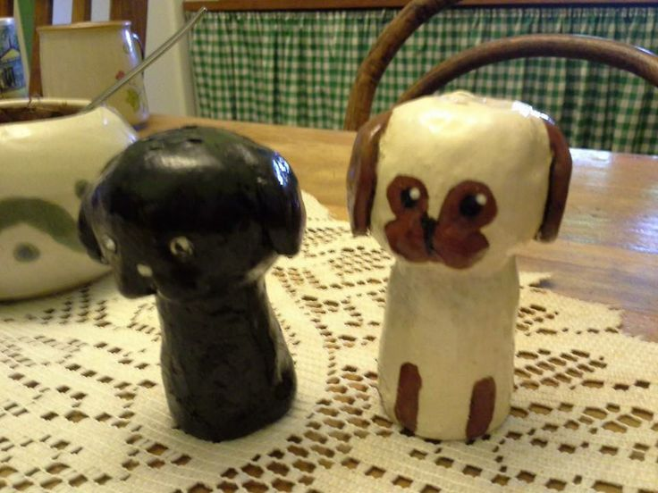 Salt and Pepper Pugs for my mother's xmas gift! Handmade: kiln-fired ceramic, underglaze, clear glaze over the top. 'Tom' The Salt Pug and 'Betty' The Pepper Pug. Modeled after her two pugs. :3