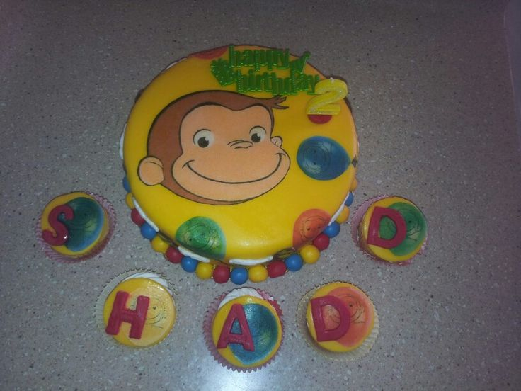 Curious george themed cake with cupcakes