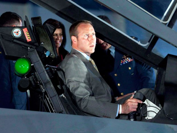 Peter MacKay checks out the cockpit of an F-35 in 2010. The F-35 was one of a string of procurement bungles during his time as Minister of National Defence.