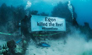 350.org underwater protest against Exxon and its responsibility in coral bleaching
