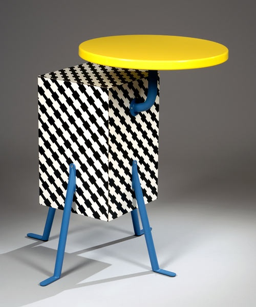 """Memphis collection created by DE LUCCHI Michele in 1981. The """"Kristall pedestal table"""" was in interpretation of the Apollo XI Space Mission where it looks somewhat like a lunar lander."""