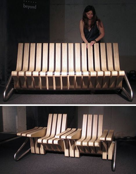 A metal frame supports the series of identical wood pieces that stack horizontally from one end to the other. Each of these modules locks into one of two fixed positions. The seating elements can be divided with temporary armrests (or wider shared working areas), or merged into a single bench seat.