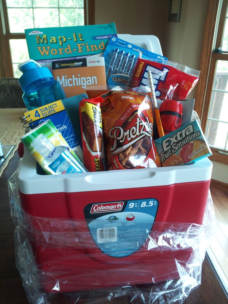 Off to college road trip gift basket! (cooler, water bottle, map, pen, notepad, tire guage, gum, snacks, hand sanitizer, tissues, flashlight, wordfind)