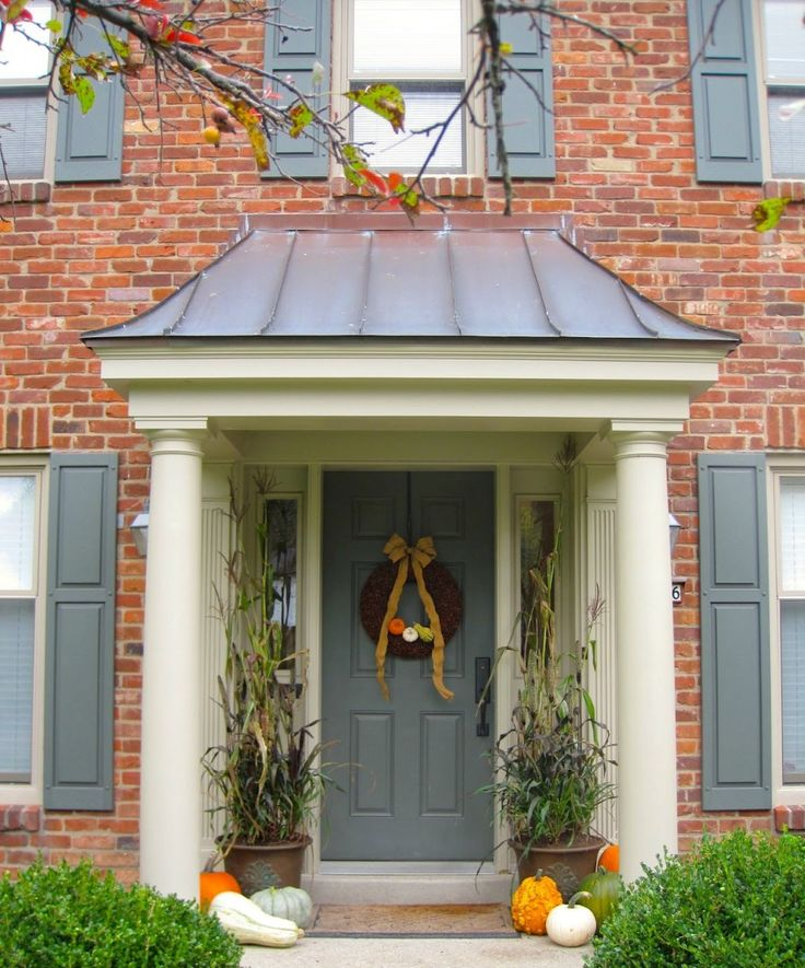 small-porch-ideas-with-overhang-plans-front-door-canopy_roofing-designs_feat-brick-wall-facade_endearing-porch-with-deck_home-design-idea_hanging-wreaths-with-yellow-bows-for-christmas-decorations_mat-945x1137.jpg (945×1137)