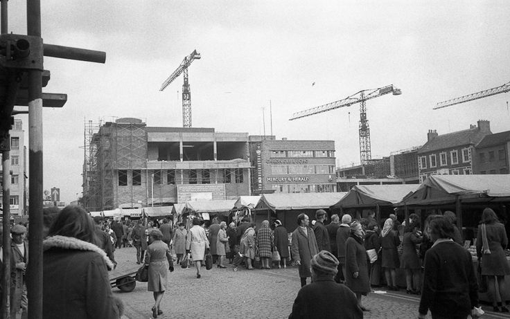 Northampton market square showing the demolition of the Emporium Arcade ready for construction of the Grosvenor Centre, early 1970s.