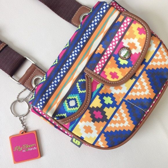 Lily Bloom NWOT Aztec Tribal Cross Body Don't let the trendy pattern fool you - this bag is GREEN! Lily Bloom is a responsible bag company that uses recycled materials to turn waste into fashion! This piece shows no use, ready for your summer plans! Lily Bloom Bags Crossbody Bags