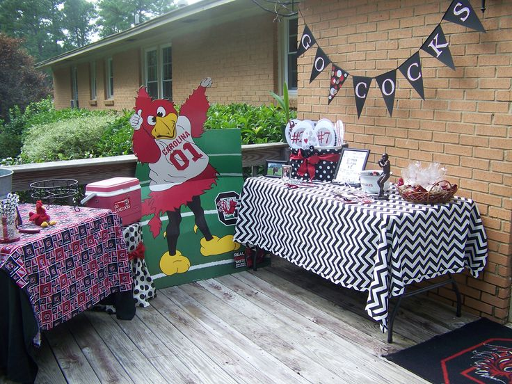 South Carolina Gamecocks Tailgating Party. Black & White Chevron Tablecloth. Go Cocks banner made with Cricut. Cardboard Cocky & Gamecock Rug.