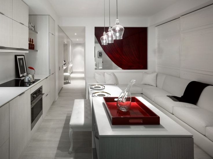 Amazing Luxury Condominium Designs with Classic Touch: Red Decorating With White Sofa In Itriguing Tower Sales Centre