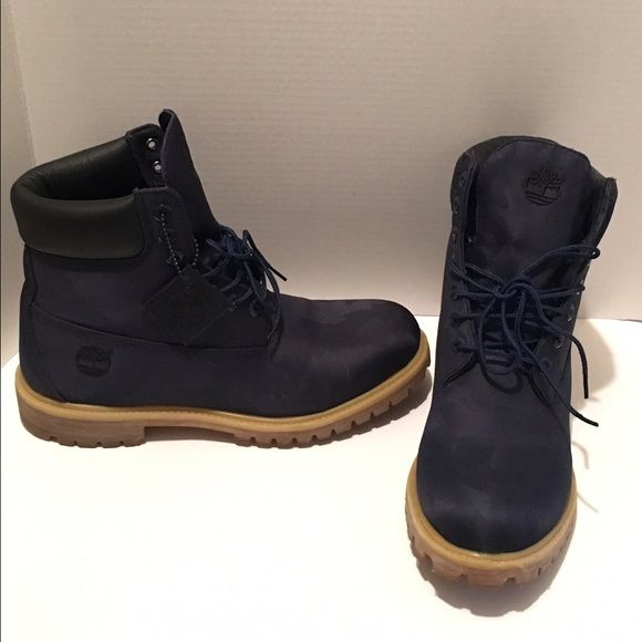Timberland boots Timberland boots only worn once! Navy blue with a hint of camouflage. Only worn once! SZ 10 in Men's Timberland Shoes Combat & Moto Boots