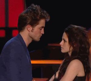 Pin for Later: Pucker Up For the Best Kisses of the MTV Movie Awards Kristen Stewart and Robert Pattinson, 2009 They teased the audience when accepting their award by pretending to go in for a kiss before backing off. Source: MTV