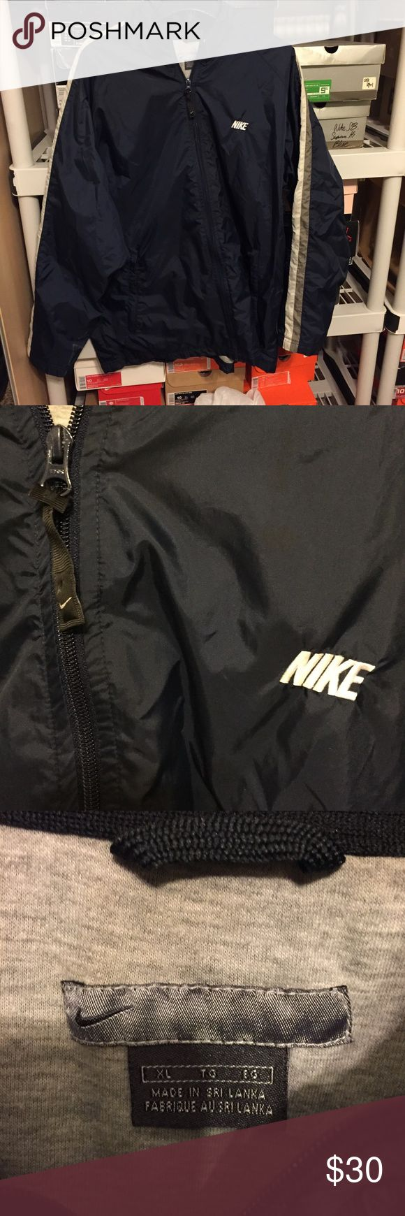 Mens Nike Athletic Navy Blue Zip Up Jacket Sz XL Men's Nike Vintage Navy Blue Windbreaker Size XL (refer to measurements)Good condition! Pit to pit: 27 inches Neck to bottom: 32 inches If you have any questions please message me thanks! Check out my other listings!! Nike Jackets & Coats Windbreakers