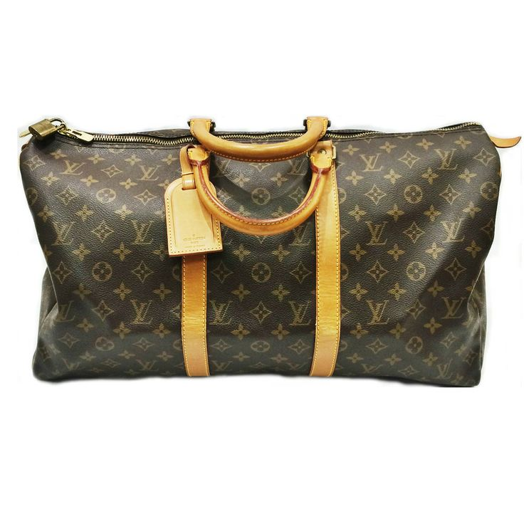 Vintage Louis Vuitton Duffle Bag! We are OBSESSED! This is the perfect back for a weekend getaway!! www.charlottesinc.com