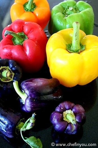 Bell Peppers which can be red, yellow, green or orange, aren't hot peppers. They are very common sweet peppers.