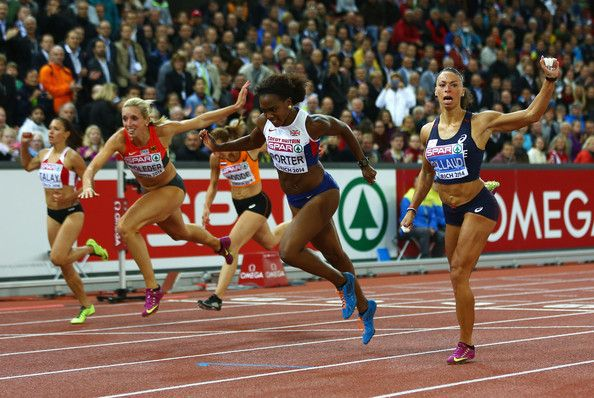 Gold medalist Tiffany Porter of Great Britain crosses the finish line to claim gold ahead of silver medalist Cindy Billaud of France and bronze medalist Cindy Roleder of Germany in the women's 100m hurdles final during day two of the 22nd European Athletics Championships at Stadium Letzigrund on August 13, 2014 in Zurich, Switzerland.