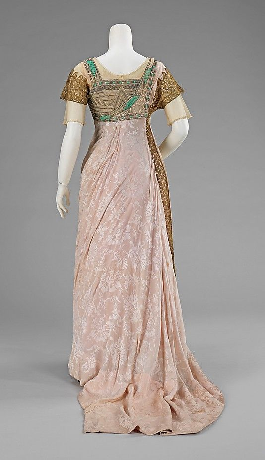 1912 Dress, Simcox, a NY dressmaker, highlights the Egyptian revival.  The dress was worn by Jeannie Lamson Currier on Jan. 4, 1912.