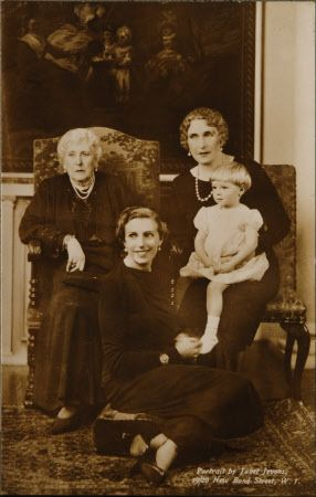 """Four generations.  Infanta Beatriz, sitting in front, with (from left) her grandmother Princess Beatrice of Battenberg, nee of UK, mother Queen """"Ena"""" of Spain, nee Princess """"Ena"""" of Battenberg, and 1st child, daughter Princess Sandra Vittoria Torlonia (held by Queen """"Ena""""),"""