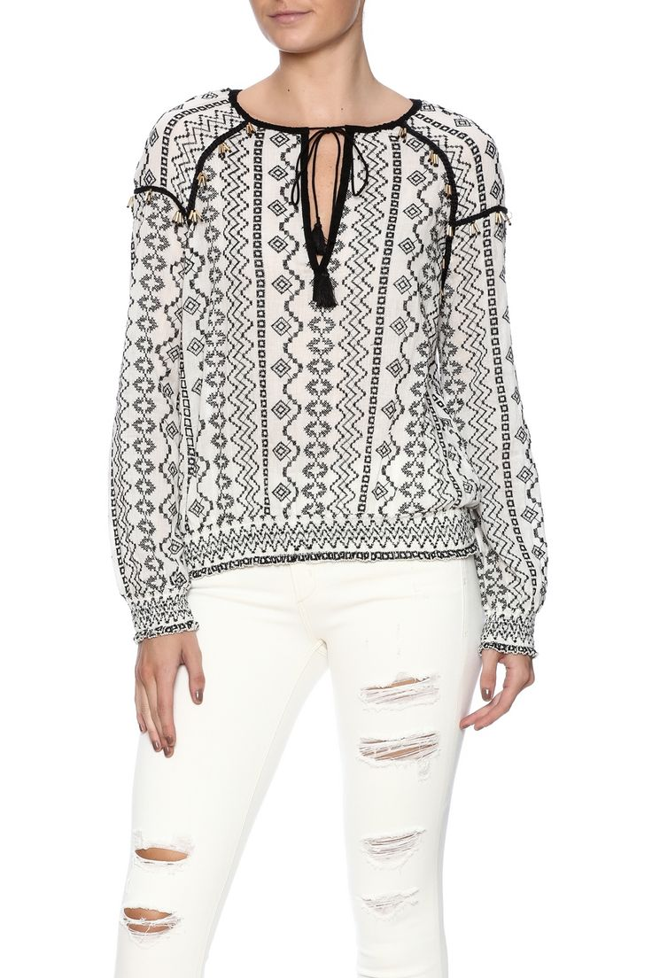 Off white black embroidered long sleeve top with gold embellishments and smocked cuffs/ waist.   White  Black Top by Saylor. Clothing - Tops - Blouses & Shirts Clothing - Tops - Long Sleeve Florida