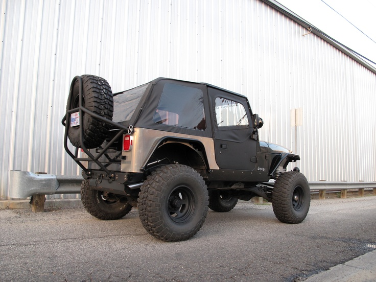 Jeep Wrangler YJ with a Rampage Products Frameless Trail Soft Top