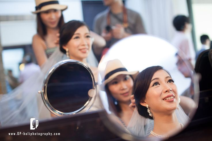 Preparation time... a picture of the Chinese bride while the makeup artist doing the hair-do for the bride.