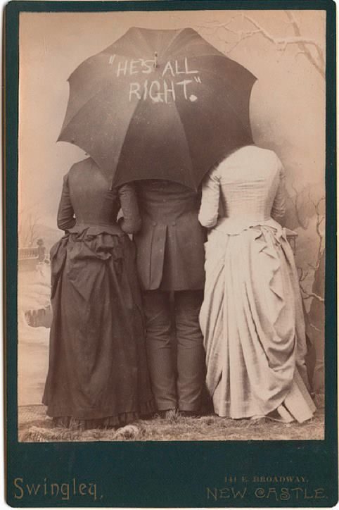 With two lovely ladies by his side, I'm quite sure he is! :) #funny #portrait #Victorian #1800s #vintage #19th_century #women #man #umbrella