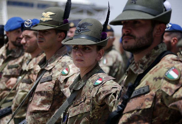 Italian armed force soldiers of the mountain unit Alpini stand in line at the Herat airfield, on June 20, 2013. (Reuters/Fabrizio Bensch)