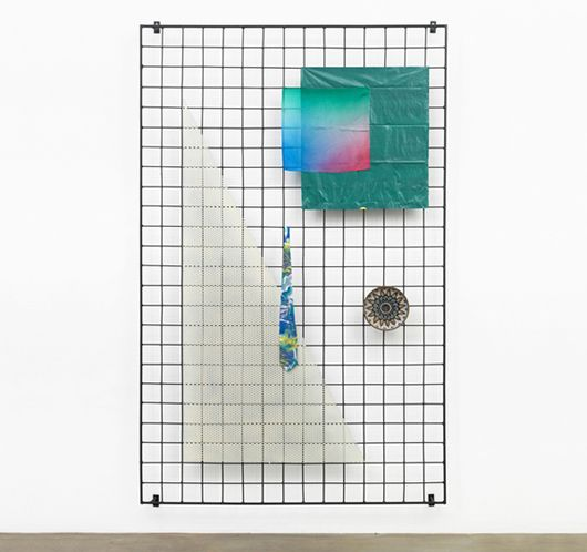 A great DIY inspired by a real artist...attach cool vintage items to a grid and hang on the wall.