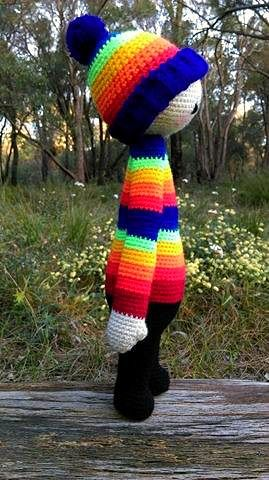 Rainbow Doll...Side.   Project information and pattern link here;   http://www.ravelry.com/projects/LindaDavie/lalylala-paul-the-toadstool-15