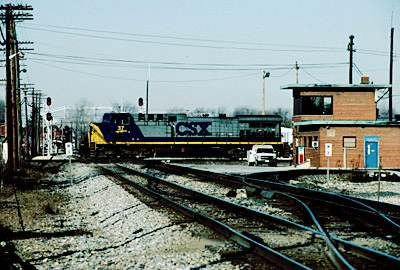 Iron Triangle, The: An area near downtown Fostoria, Ohio where two main lines of CSX Transportation (the former Baltimore and Ohio line between Akron and Chicago and the former Chesapeake and Ohio Railway line between Columbus and Toledo) and one main line of Norfolk Southern (the former Nickel Plate Road line between Bellevue and Fort Wayne) cross each other in close proximity. Fostoria provides countless opportunities and angles for train watchers.